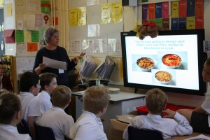 Janet gives the children a brief presentation on healthy eating, the food groups and the benefits of including seafood.