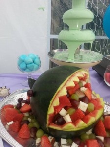 Watermelon shark! White chocolate fountain in the background with blue food colouring to create a 'sea' effect.
